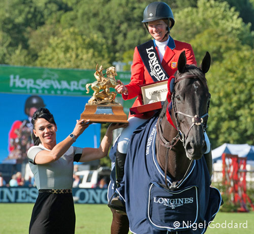 Beezie Madden receives the King George V Gold Cup for her win on and Cortes C.