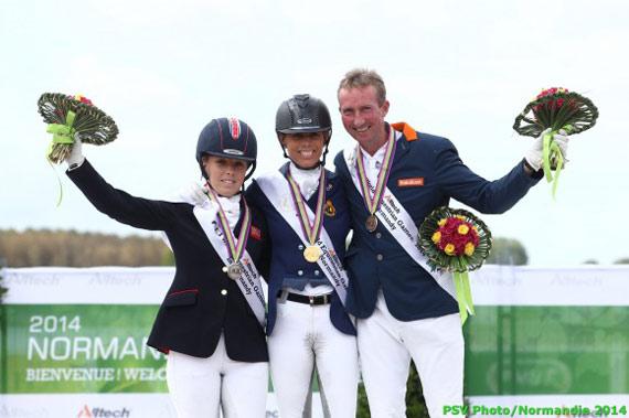 Grade IV gold medalist Michele George is flanked bySophie Wells (bronze) andFrank Hosmar (bronze).