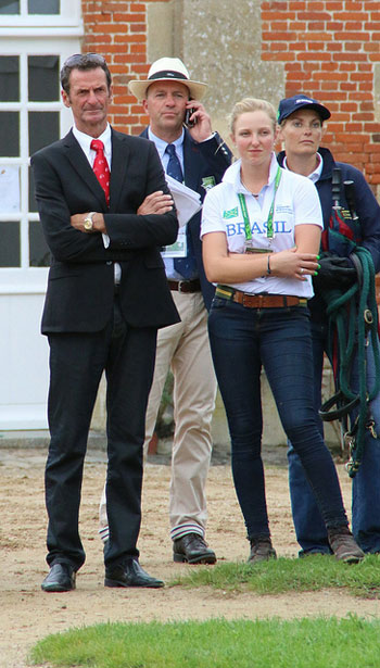 New Zealand's Mark Todd watching the horses trot up with the Brazilian team, which he helps coach.