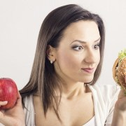 smiling-healthy-woman-with-apple-and-hamburger