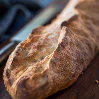 An artisanal bread that looks bakery made but done in your kitchen. The crust is crunchy crust and a tender flavor. The garlic flavor is present without taking over   HostessAtHeart.com
