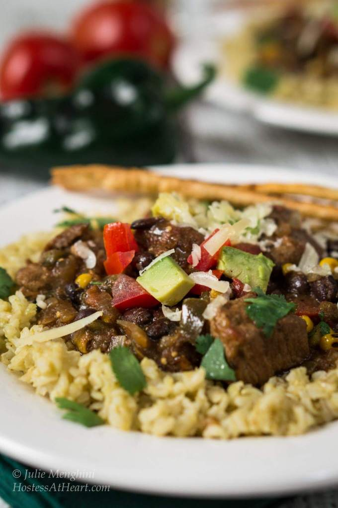 Poblano Pork Stew over Tomatillo Rice is rich in flavors and has a ...