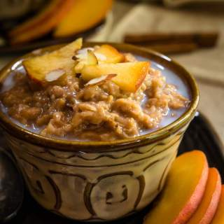 Crockpot Steel Cut Oats & Bulgur is like waking up to a warm cinnamon hug. It's great as is or with fruit, nuts, and a drizzle of milk or cream. It makes several servings and freezes well | HostessAtHeart.com