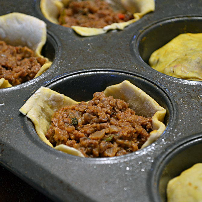 The first batch of 3-Bite Jamaican Beef Patties being filled.