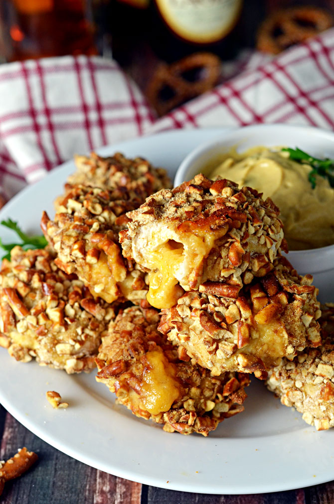 Pretzel-Crusted Chicken Nuggets Stuffed with Beer Cheese.  These make the perfect Super Bowl appetizer or party treat.  Grown-up chicken nuggets that make your taste buds smile. | hostthetoast.com