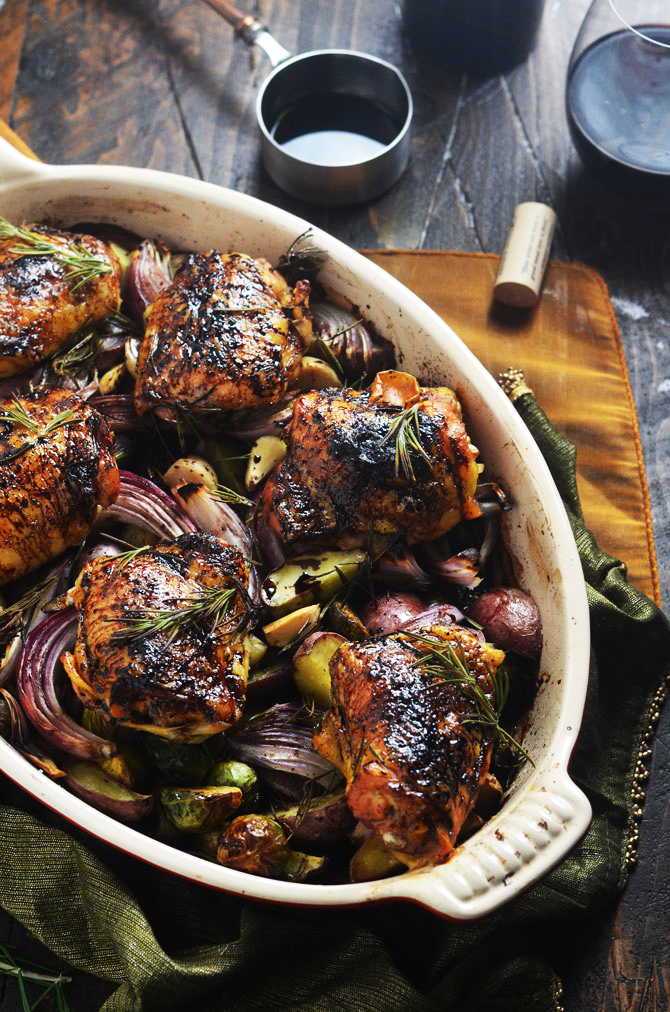 . Juicy, crispy-skinned chicken thighs rest over a bed of potatoes ...