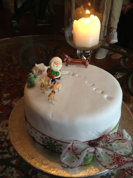 A Christmas Cake decorated by a six-year old complete with Santa's footsteps