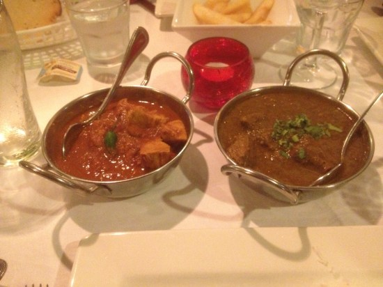 The two curries with Alfie's chips in the background