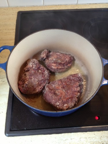 Brown the meat in heated olive oil