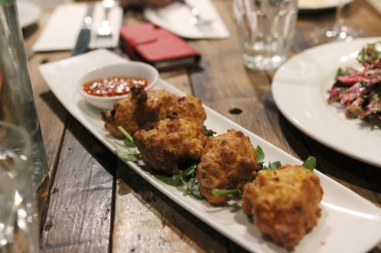 Sweet born fritters with seven-day hot sauce $10