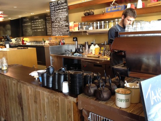 The coffee bar and the empty blackboards behind the counter