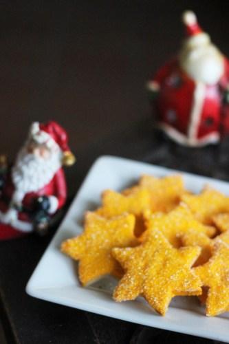 Golden stars sparkling in sugar-glitter