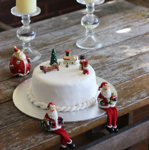 A Christmas cake covered in marzipan then white fondant