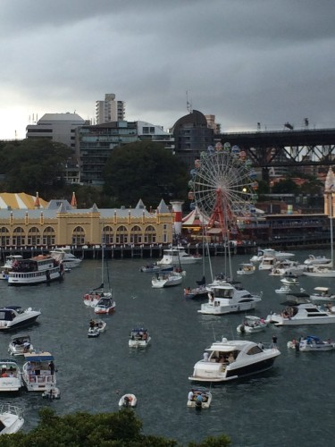 Anchored boats waiting for the show to begin and across the water is Luna Park.