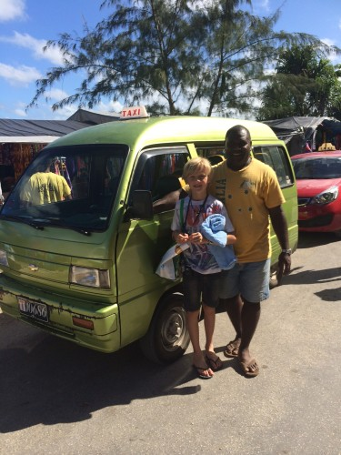 Our taxi driver and tour guide, Willie, with his green and gold Australian T-shirt and his under-powered van with no air-conditioning.