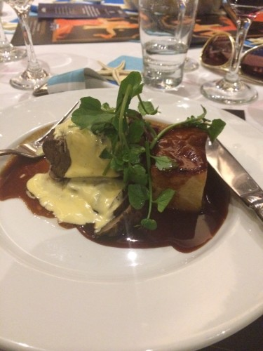 Pure Angus beef tenderloin with Portobello mushroom, potato fondant, hollandaise and beef jus