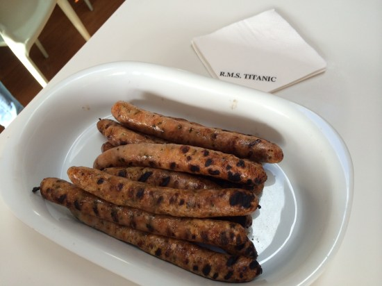 Chicken sausages beside an RMS Titanic cocktail napkin - I have a few leftover!