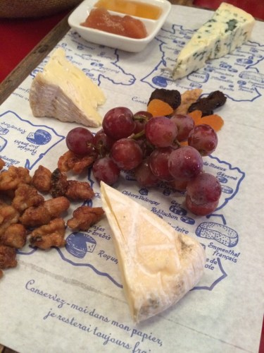 Cheese and fruit served on a map of France