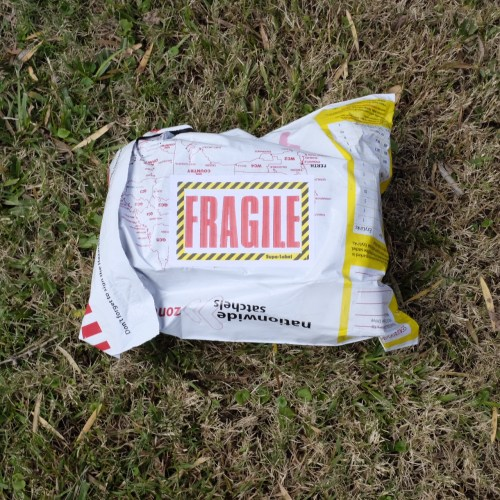 Fragile means 'handle with care'.