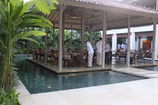 The dining area is surrounded by water features