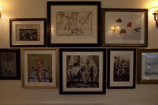 A wall of framed art