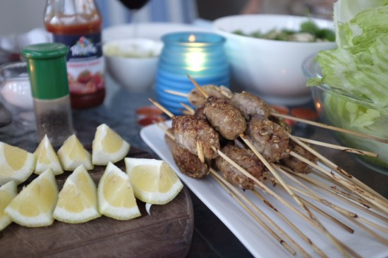 Lamb kofta sticks with lemon wedges