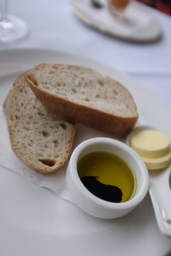 Warm bread with olive oil and balsamic or unsalted butter