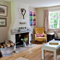 Traditional living room with exposed brick chimney breast ...