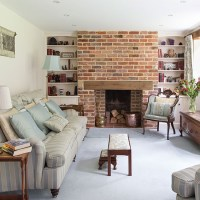 Traditional living room with brick chimney | Traditional ...