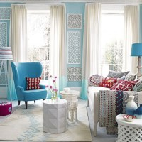 Blue and white living room with carved wood panels ...