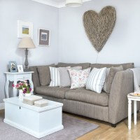 Pale grey living room with wicker heart wall art ...