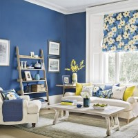 Modern blue living room with forsythia yellow accents ...