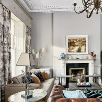 Pale grey living room with patterned curtains and period ...