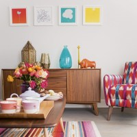 Modern living room with retro sideboard and pink and blue ...
