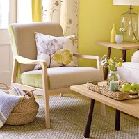 Yellow living room with pretty floral prints and armchair ...