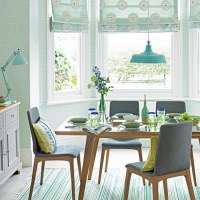 Mint green dining room with mid-century style furniture ...
