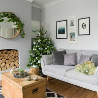 Modern pale grey living room with Christmas tree ...