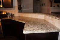 New venetian gold granite   Hardwood Flooring Houston