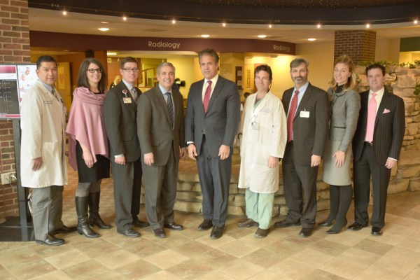 Representative Mike Bishop visits SJMB to learn about the Livingston Transformation. L to R Dr Angel Gomez (SJML), Tonya Wells, Michael Miller, Rob Casalou, Rep. Mike Bishop, Dr. Fields (SJML), Dave Brooks, Laura Fellow (Trinity), Mark Corriveau (Trinity)