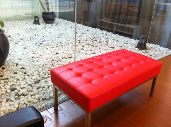 Red leather upholstered ottoman bench