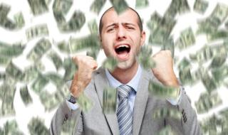 man-shaking-fists-happily-in-air-money-falling-around_573x300