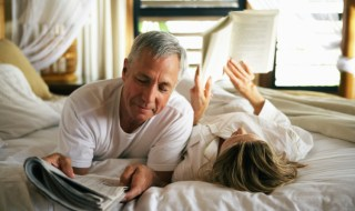 Senior couple reading in bed, close-up