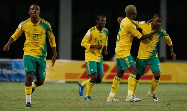South Africa's Elrio van Heerden (R) celebrates his equalising goal against Angola with team mates Thembinkosi Fanten (L), Teko Modise (2nd L) and Sibusiso Zuma during their first round Group A match of the African Nations Cup soccer tournament in Tamale, January 23, 2008. REUTERS/Finbarr O'Reilly (GHANA)