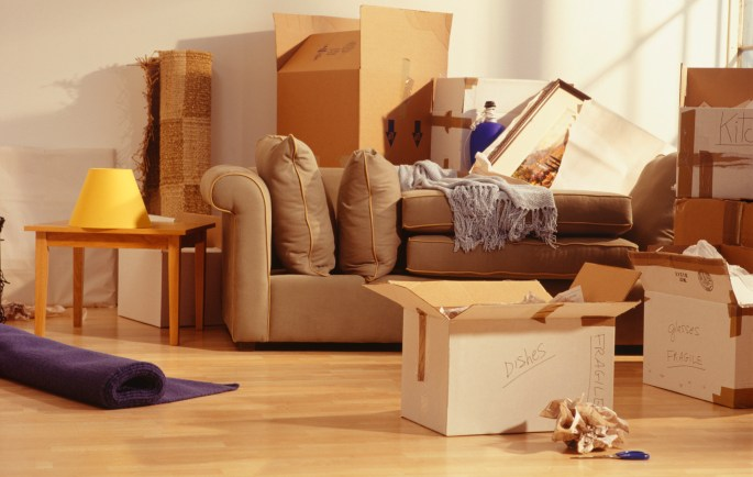 Unpacked moving boxes in Living Room