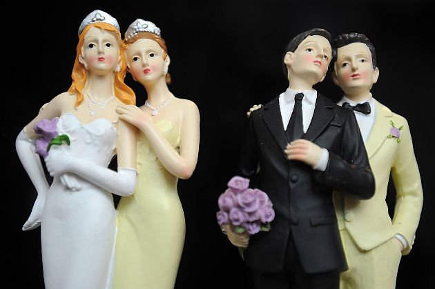 PARIS, FRANCE - APRIL 27:  Plastic figurines of same-sex couples are displayed at the gay marriage show on April 27, 2013 in Paris, France. The show takes place four days after France legalised same-sex marriage at the National Assembly. (Photo by Antoine Antoniol/Getty Images)