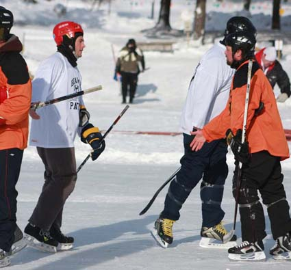 skaing hands pond hockey