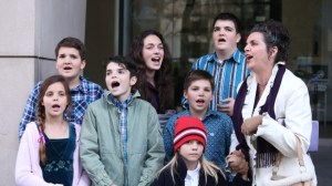 Odalis Sharp and several of her children sing outside the federal courthouse Wednesday, Feb. 24, 2016. The Sharps were there to support Ammon Bundy and other defendants who have pleaded not guilty to a federal conspiracy charge related to the armed takeover of an Oregon wildlife refuge. (Beth Nakamura/The Oregonian via AP) MAGS OUT; TV OUT; NO LOCAL INTERNET; THE MERCURY OUT; WILLAMETTE WEEK OUT; PAMPLIN MEDIA GROUP OUT; MANDATORY CREDIT
