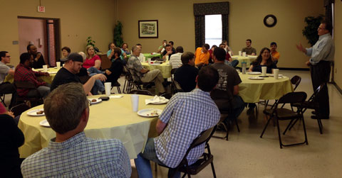 Summer intensive students discuss ministry challenges over lunch with Dr. Carlus Gupton