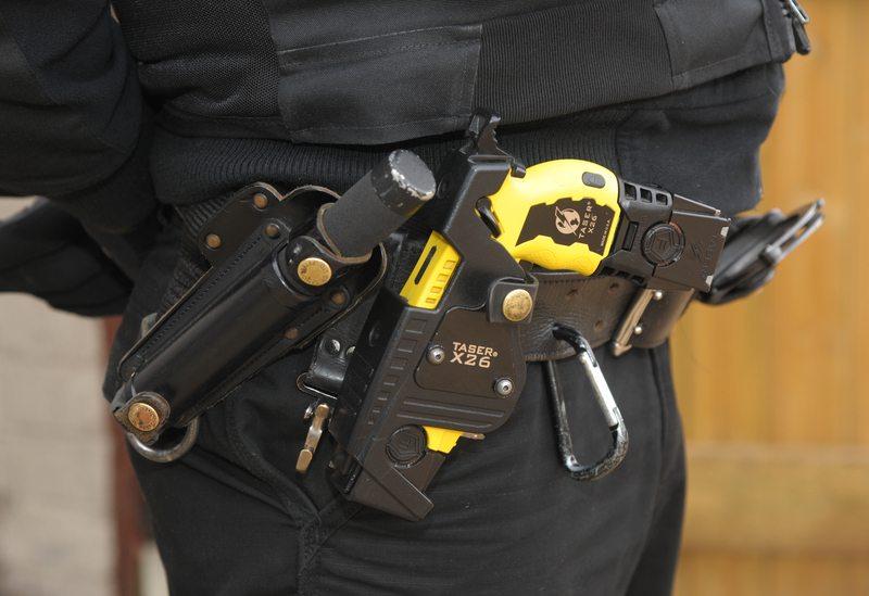 © Martin Brayley | Dreamstime.com - Police Taser gun