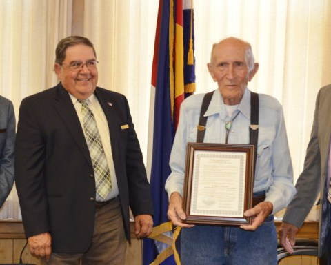 The Huerfano County Commissioners this week proclaimed by resolution August 31, 2016 as Robert J. 'Jack' Coe Day in Huerfano County in recognition of his service as a US Navy Seaman First Class stationed in San Diego, Calif., and the Philippines.  While in the Navy Coe was the awarded the Presidential Unit Citation.  From left, commissioners Gerald Cisneros, Ray Garcia, 'Jack' Coe and commissioner Max Vezzani.